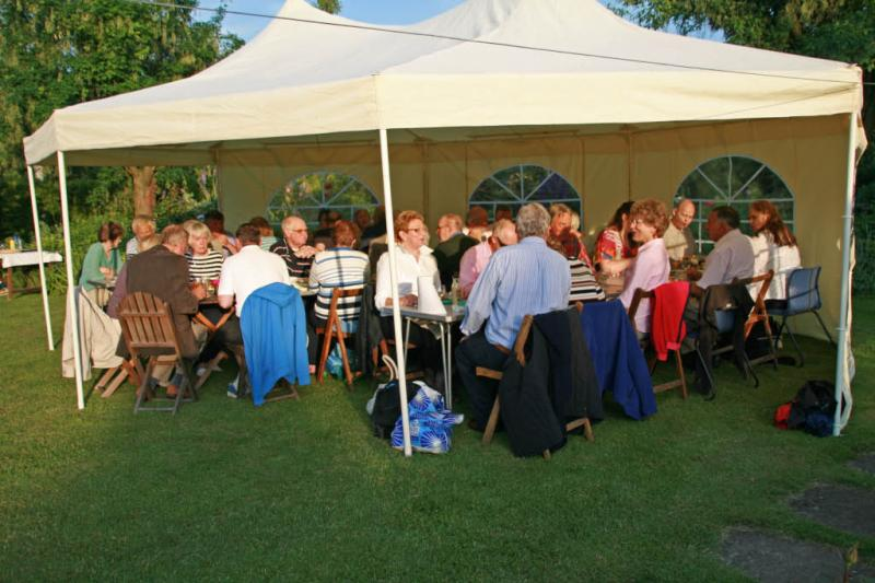 Jun 2012 Club Barbeque - Harlton (no meeting at the University Arms) - Members partners and guests enjoying one of the few sunny evenings in June 2012 in John and Molly's well tended garden.