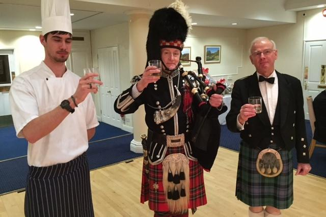 Enjoying a tipple after addressing the haggis at the annual Burn's Night event.