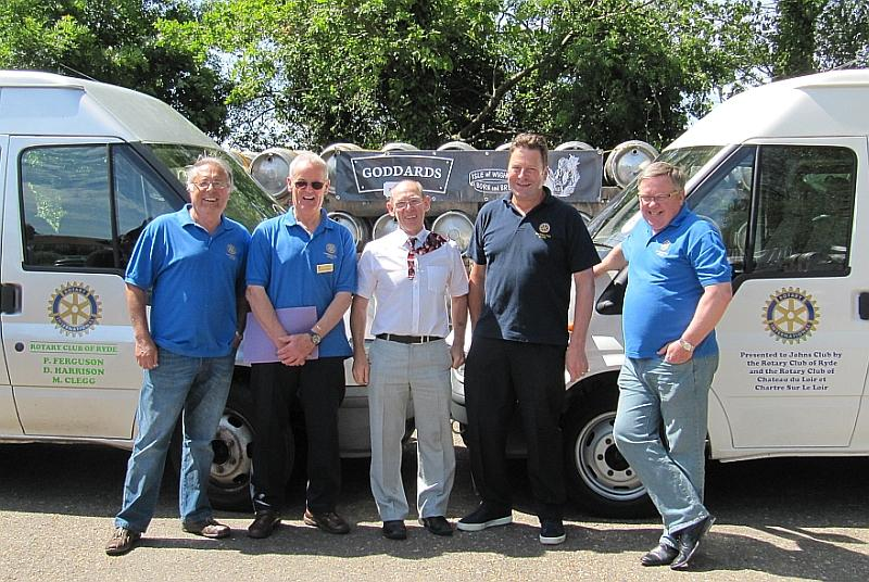 Ryde Rotarians present two minibuses to John's Club