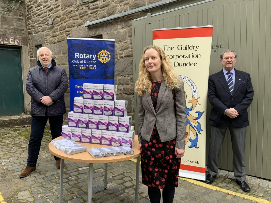 Rotary Club President Clive Murray, Professor Isla Mackenzie and Lord Dean of Guild Scott Williamson with the monitors.