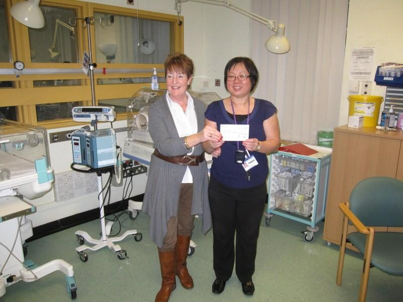 Special Care Baby Unit at Mayday receives Rotary donation - Sister Ooi (right) receives a donation of £1,450 from Jane Hurlock.