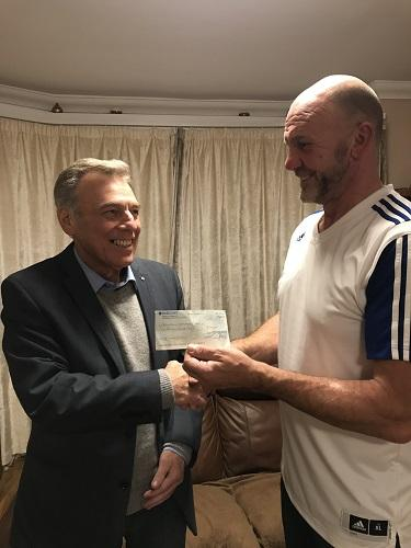 Terry Maguire (BFY) receiving a cheque for £500