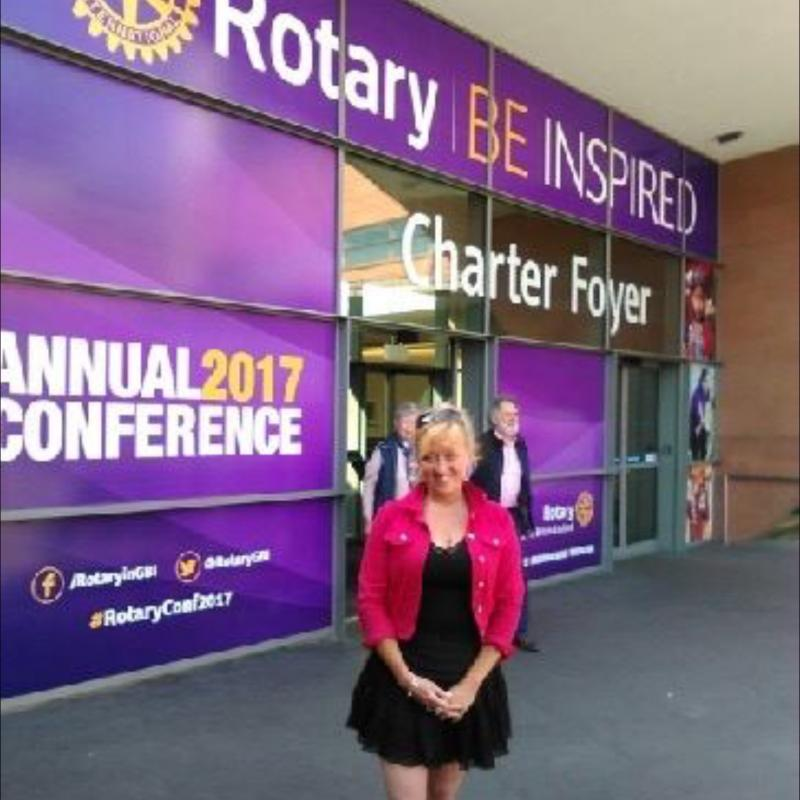 Vice President of Tameside Rotary Club Yvonne outside Conference Centre Manchester