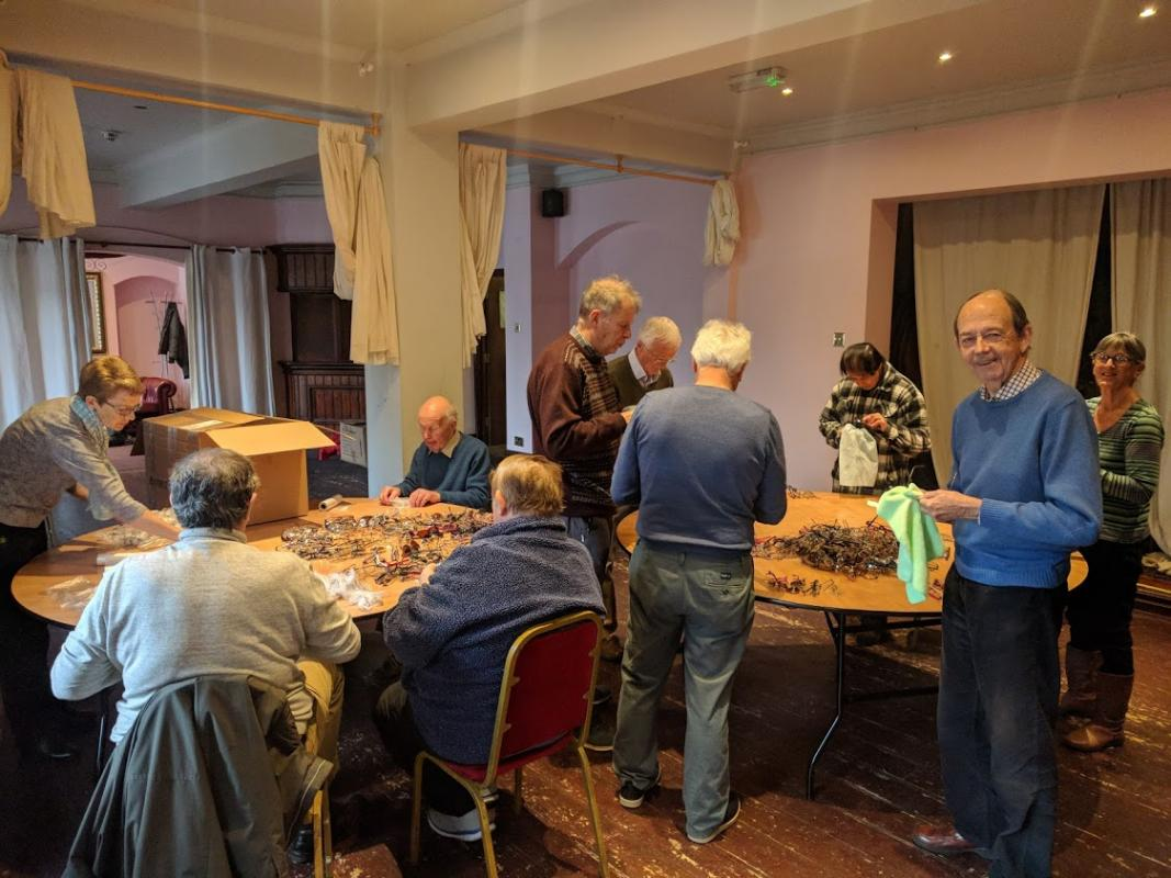 Stroud Rotarians cleaning glasses ready to ship to Sri Lanka. In a morning we cleaned, sorted and packed over 1,300 specs.