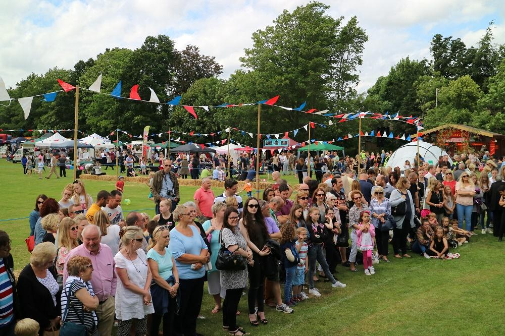 Family and friends gather to enjoy the atmosphere in the arena. A dog show, classic car rally, live bands, dancers are just some of the attractions available.