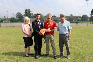 Defibrillator For All Saints Academy - Rotarians presenting the defibrillator to Principle Dermot McNiffe