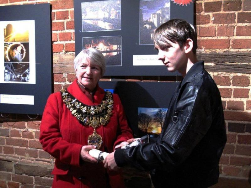 Scott Boyd receiving his award from the Mayor of Newbury
