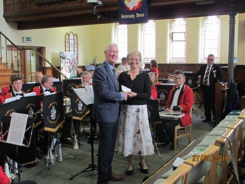 President Bruce Liddle presenting a cheque to Mrs Diane Diacon, Chair Broxtowe Women's project
