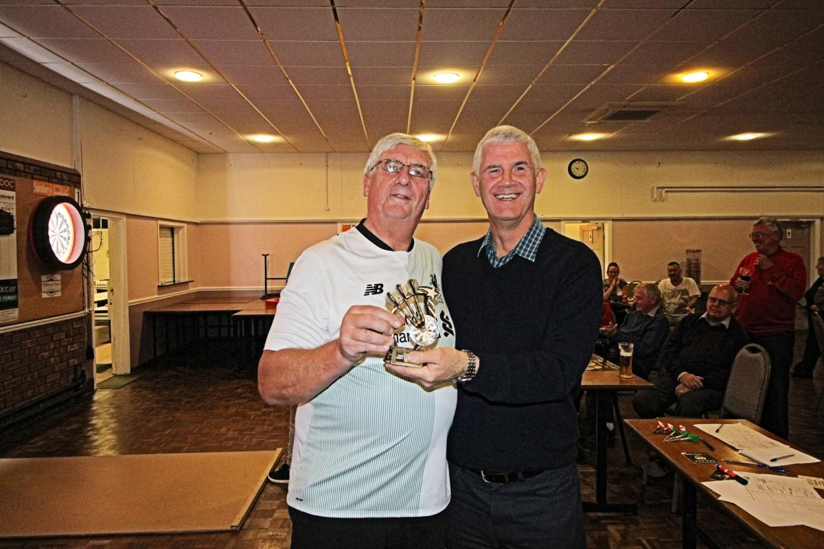 President Paul presenting the winners trophy to Bill Arnold (right)