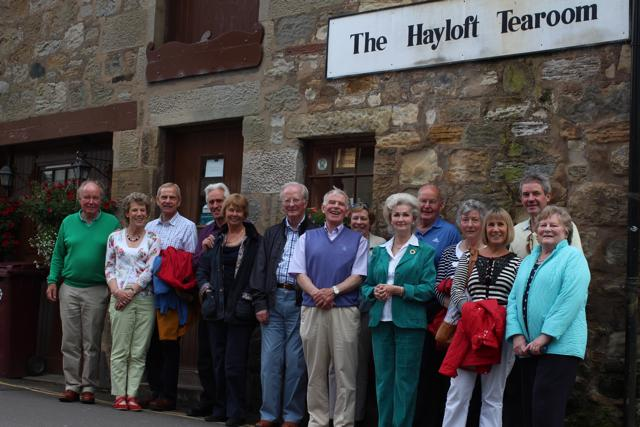 Well fed group in front of Marta's tearoom