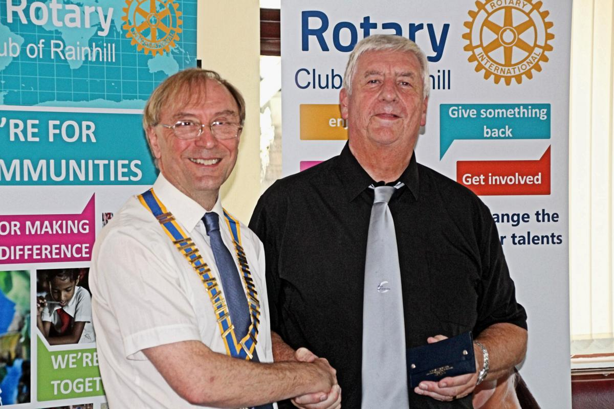 New President Tony Lewis (left) taking the reins at Rainhill Rotary from out-going President Paul Worral