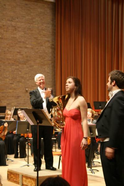 Feb 2012 Charity Concert  West Road Concert Hall Cambridge  - Soloist Horn player Anna Douglas and Tenor Stuart Jackson being applauded by Conductor Leon Lovett