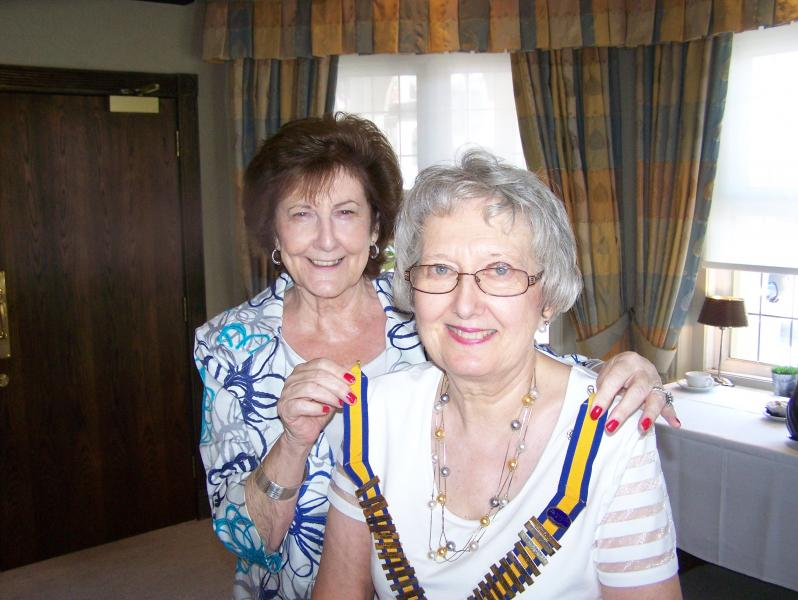 Out going President Jean Davis placing the chain of office round Christine Heybourn's neck