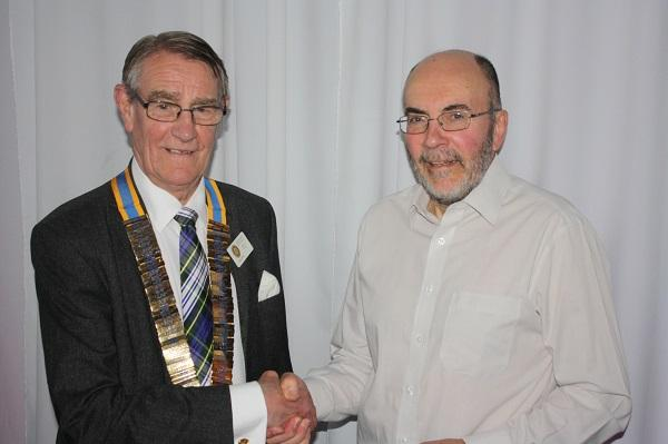 Outgoing President Ken Kerr handing over the chains of office to new President Hedley Hill