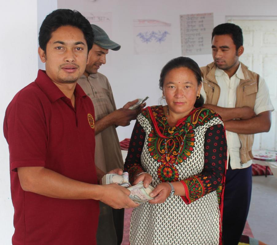 RC Dhulikhel in Nepal with then President Ranjeev distributing loan money.