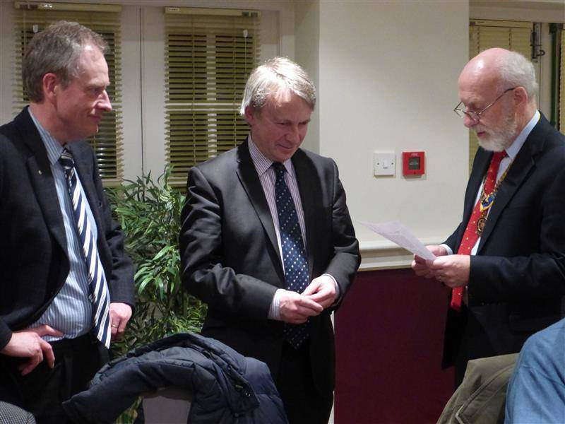 Jeremy Burchill inducted as member - Jeremy Burchill being inducted by President John Morton, with Sponsor Michael Hepper