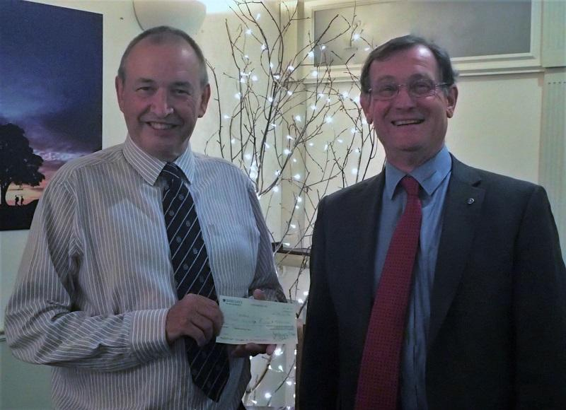 John Priddle from the Jigsaw Appeal receiving a cheque from President Elect Don Jary