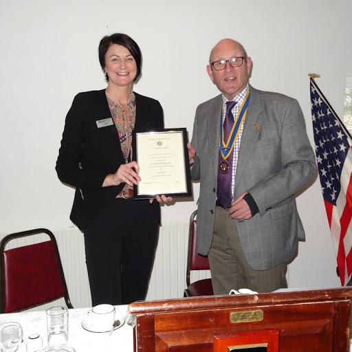 Friends of Rotary - Jo Yates receiving the Wigan Friends of Rotary Certificate to acknowledge the work that Metro Rod do in supporting the work of Wigan Rotary Club in the Community.