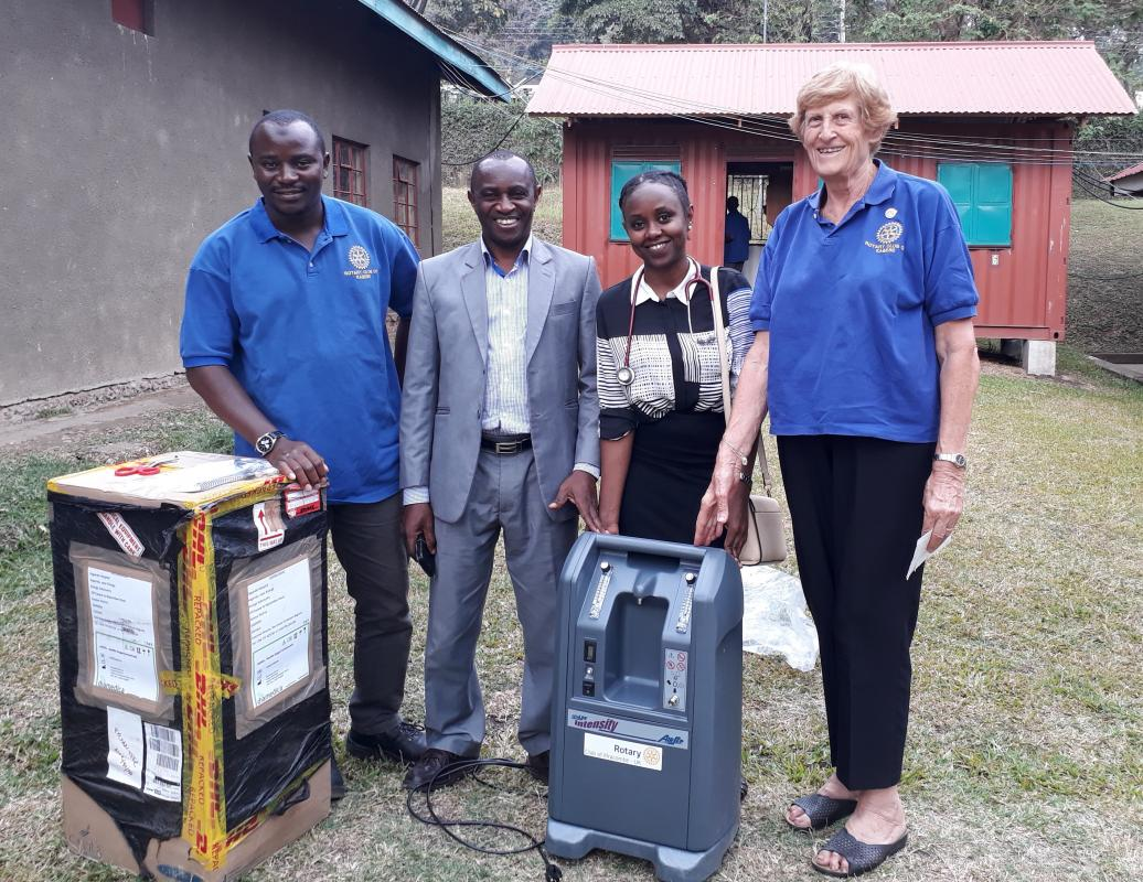 The photo shows the two essential Oxygen concentrators being unpacked at Kagando Hospital alongside two local Rotarians are Canon Dr Benson Baguma the hospital Director and with the stethoscope is Dr Kemigisha the emergency doctor.