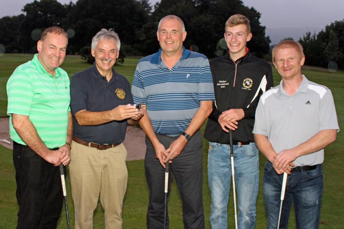 Picture shows Rotary President Ian Morrison with a delighted Keir Garage team of (L to R) Iain Brown, Robert McQuat, Ryan Cano and David McCrone