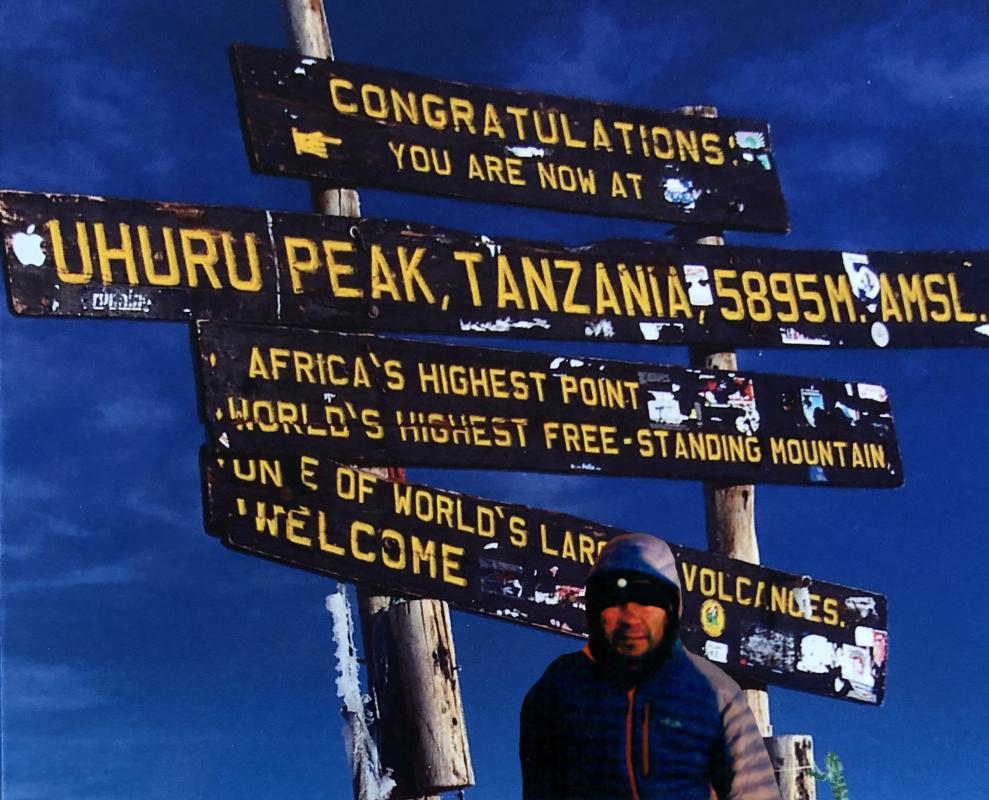 Standing at the Summit of Mount Kilimanjaro