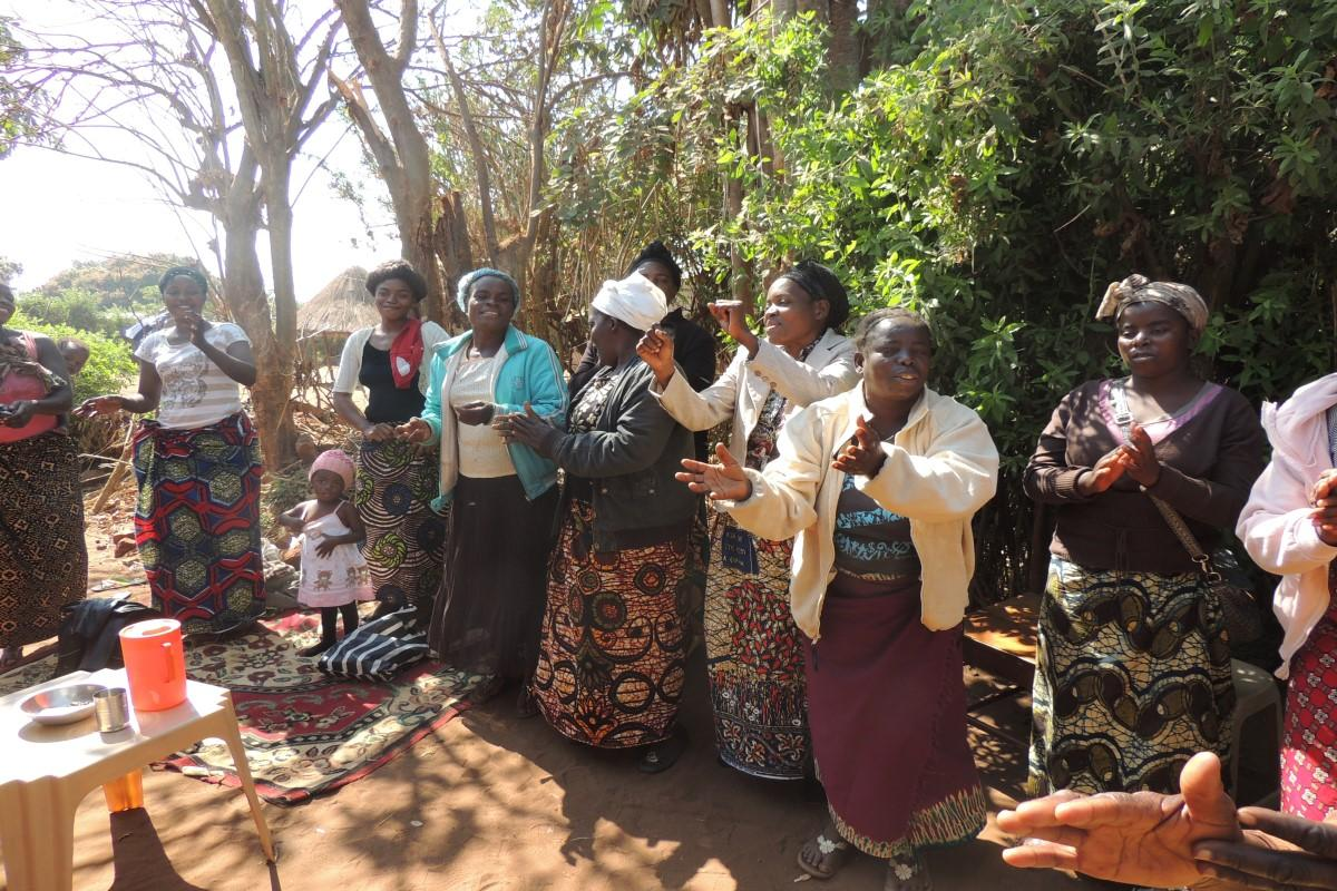Ladies of the Madelitso Group in Lilongwe District Zambia, celebrating repayment of loan from Lendwithcare.