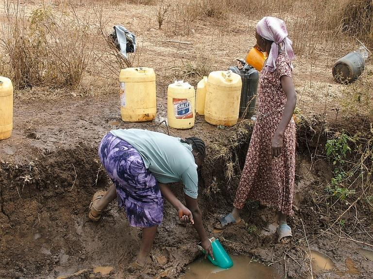 Our work providing clean water  - How villagers used to collect water