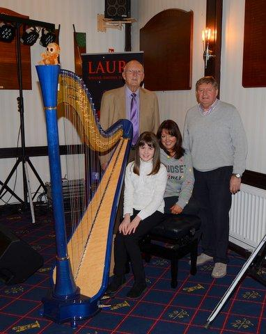Harpist Paige McDonald and singer Laura Johnston with Past-Presidents Billy Wilton and Terry Cromey at the Annual Dinner