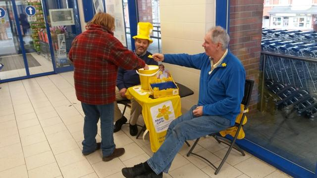 Rotarians Ifor and Nigel with another happy customer supporting Marie Curie