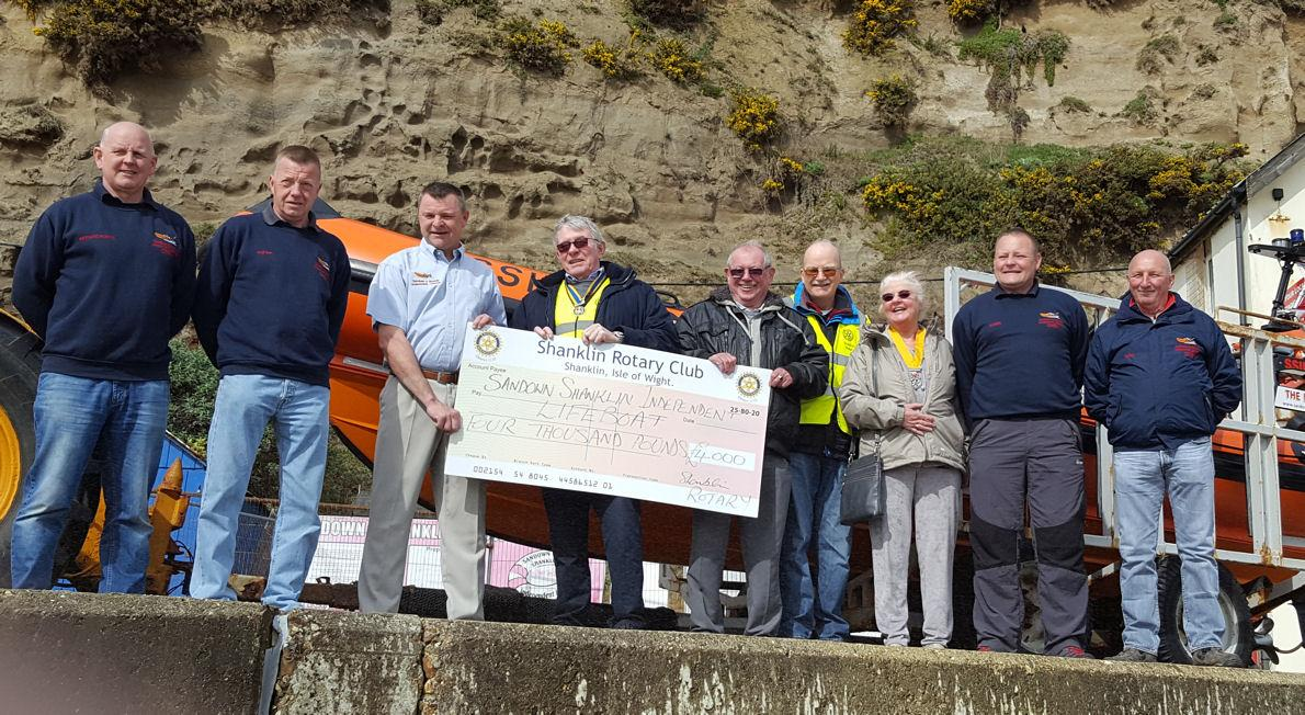 Shanklin Rotary Club President, Steve Knight, presents the cheque for £4,000 to Lifeboat crew members.