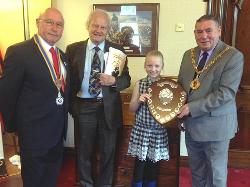 Lucy Berry Receives the JKJ Shield for her entry in the writing competition.