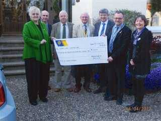 President Andy Kerr presenting cheque to Judith Hall from Marie Curie