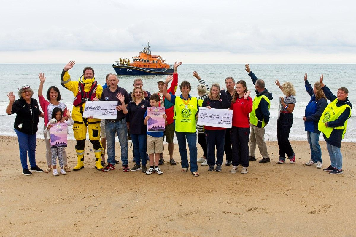 Martello Rotarians on the beach at Seaford with members of Newhaven RNLI and Seaford Lifeguards