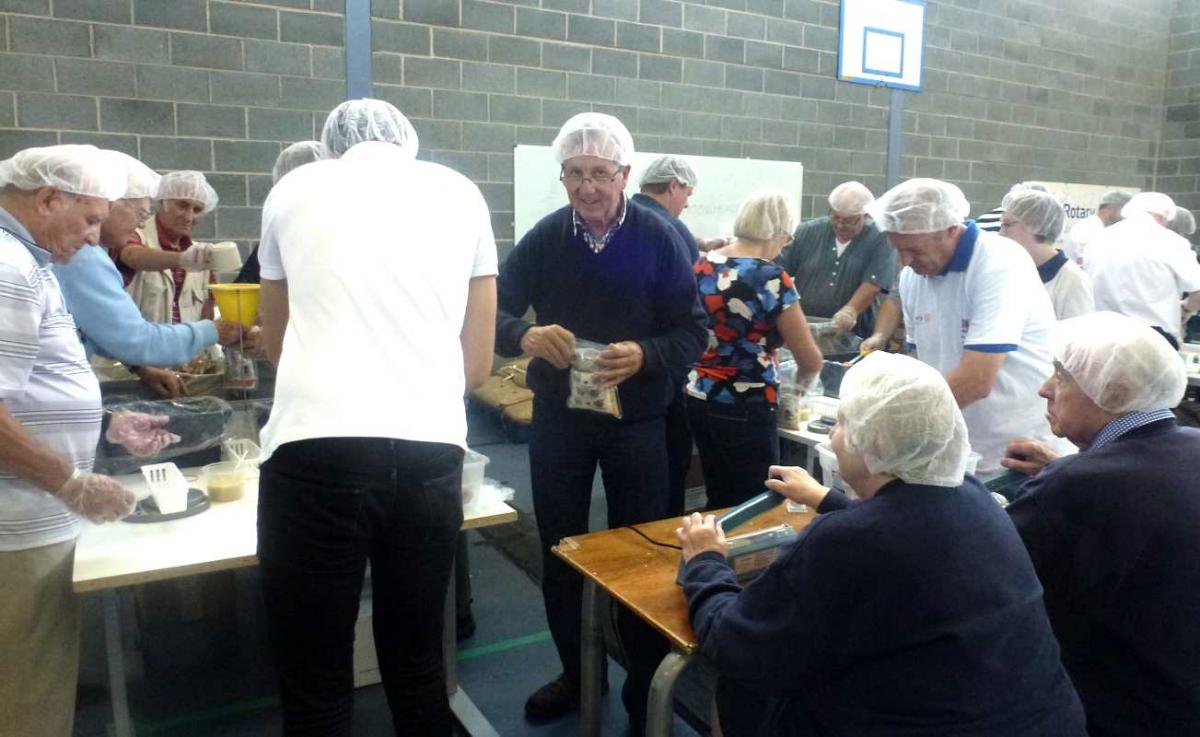 Members packing food parcels for school children in Kenya