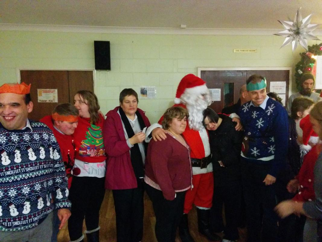 Mencap Christmas Party - Santa brings a smile to a lot of faces.