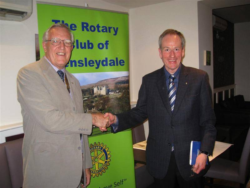 Michael Hepper being congratulated by President John Ogbourne