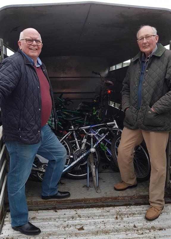 Mike McNeice and John Perry load up bikes for Bike Aid Africa