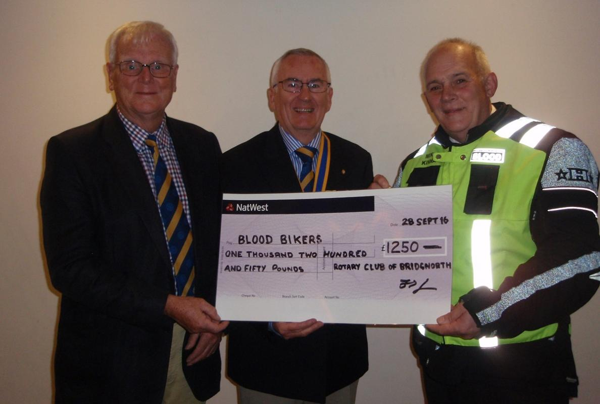 Mike Kinna of Blood Bikers accepting cheque