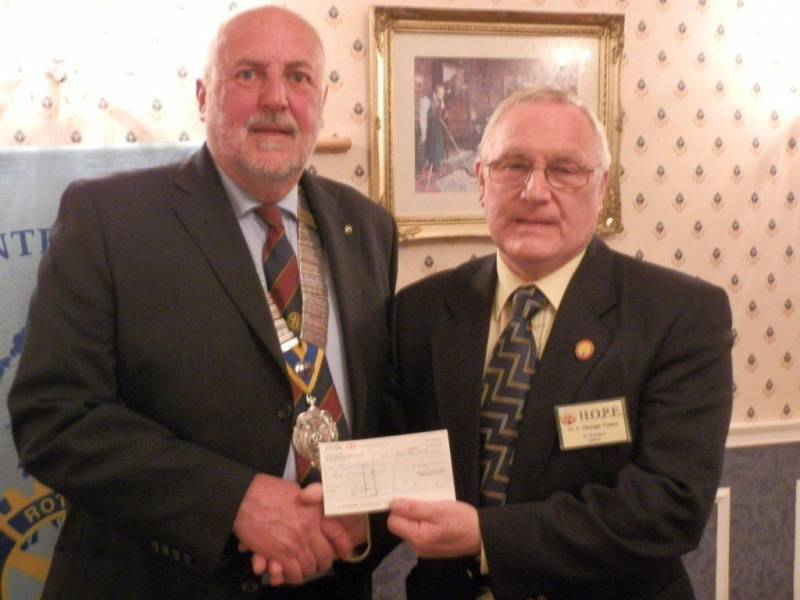 Mr Ken Brombley, Chairman of H.O.P.E. receives a cheque from 2011-2012 Rotary Club of Tenby President Alan Jones
