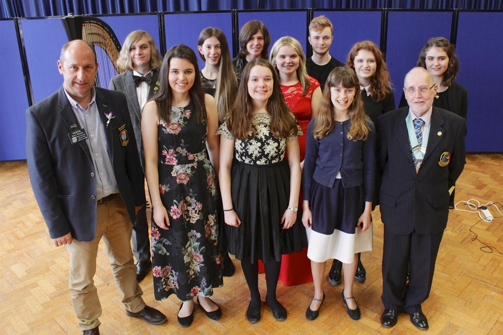 Young Musicians and District Governors Steve Martin (District 1180), left and Tony Graves (District 1285)