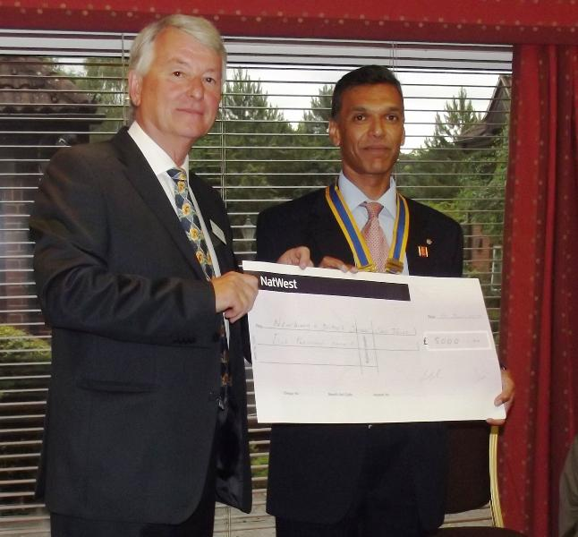 Cheque presented to NDCCT at Club President's Handover Dinner - David Ball, Chair of NDCCT receives cheque for £5000 from incoming Club President, Hemant Amin