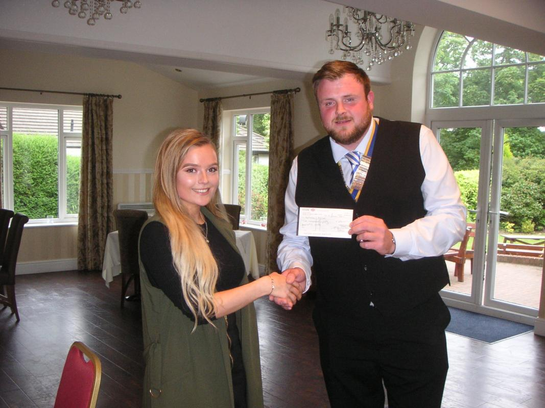 President Mike gives Natasha £250 towards the cost of her project