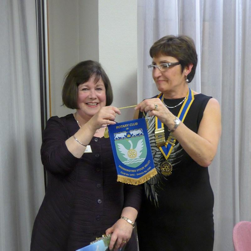 Visits to other clubs - Sue Clark presenting our club banner to President Christine Voltz of the Rotary Club of Nancy Majorelle.