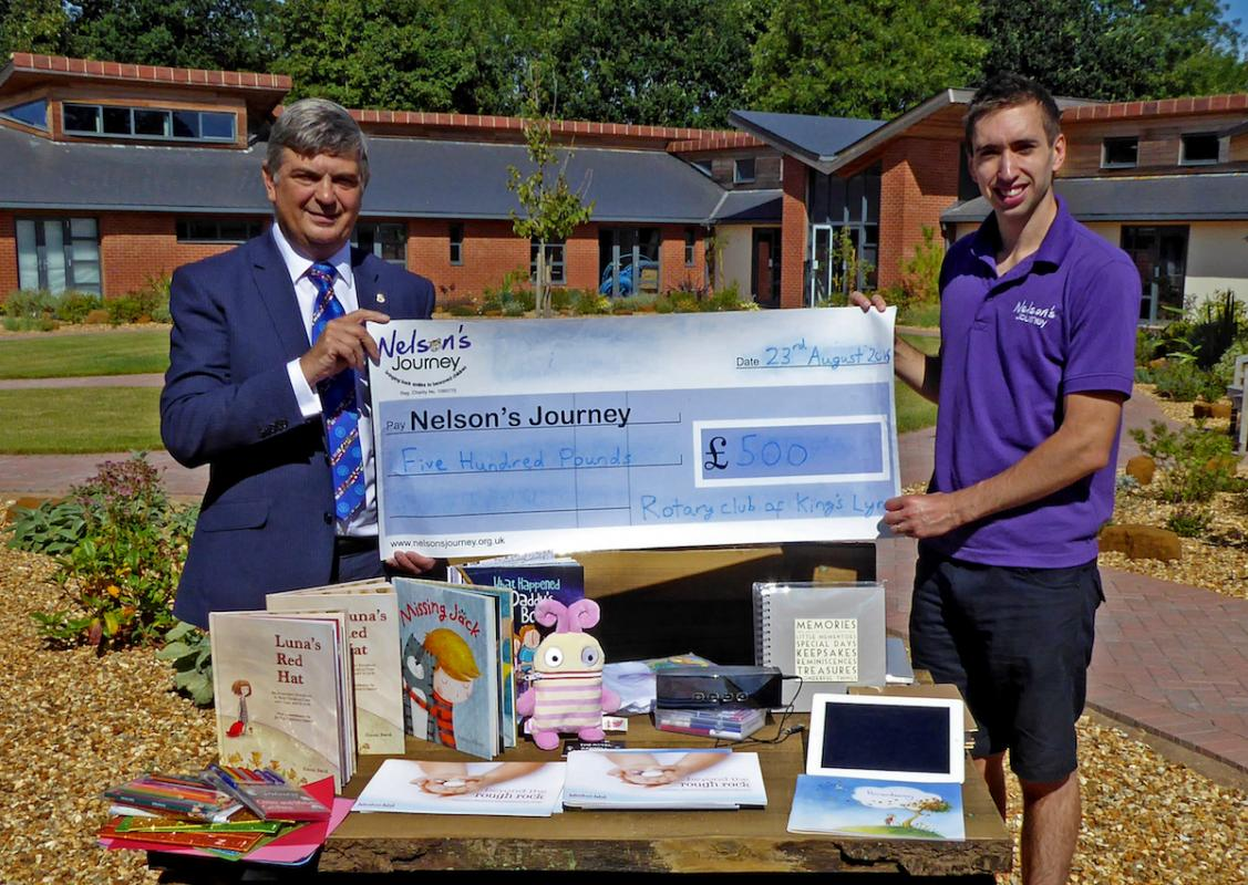 The photograph taken at The Norfolk Hospice (where Nelsons Journey has a facility) is of:    left - Michael Pellizzaro, President of the Rotary Club of King's Lynn and Adam White, Children's Support Worker for Nelsons Journey - the cheque is for £500