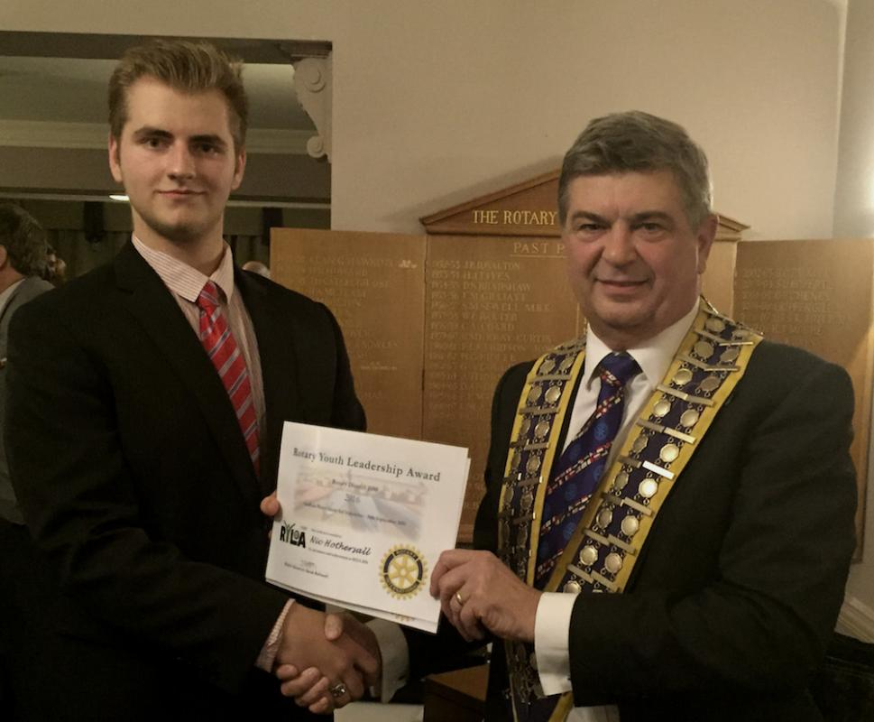 Nic Hothersall being presented with a RYLA Award Certificate at a Rotary Meeting by Club President Michael Pellizzaro.