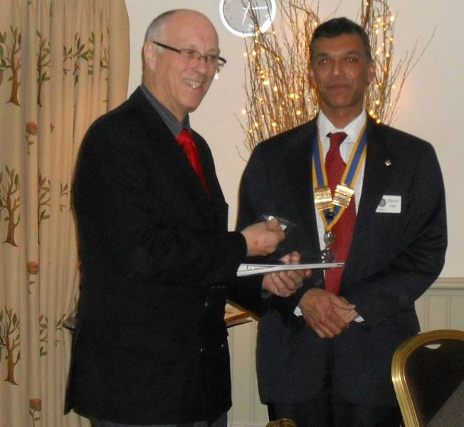 Nick Buraston being welcomed to the Club by President Hemant Amin