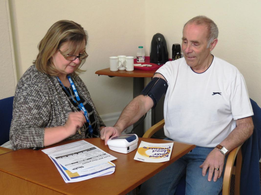 Know Your Blood Pressure - Nurse Karen Fenwick taking the blood pressure of Terry Burgess.