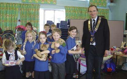 Isabelle's friends with James Lang, President of Windsor & Eton RC at the Oakfield School Bring & Buy