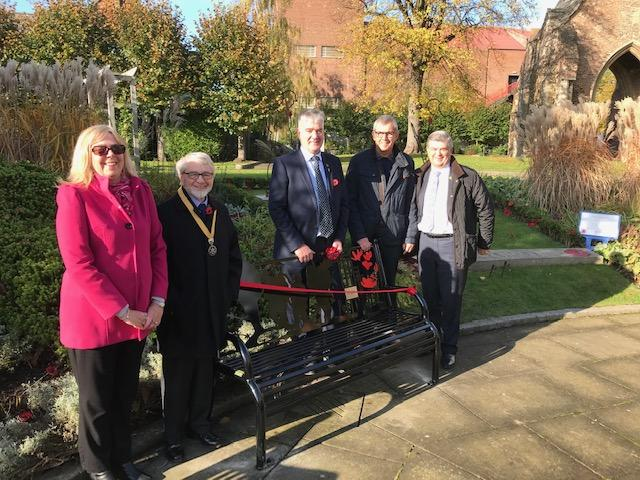 Rotarians and the new bench paid for by the Rotary Club of King's Lynn