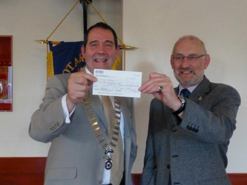 Immediate Past President Tony Neeson, the happy winner of the big prize in June 2013 being presented with his cheque.